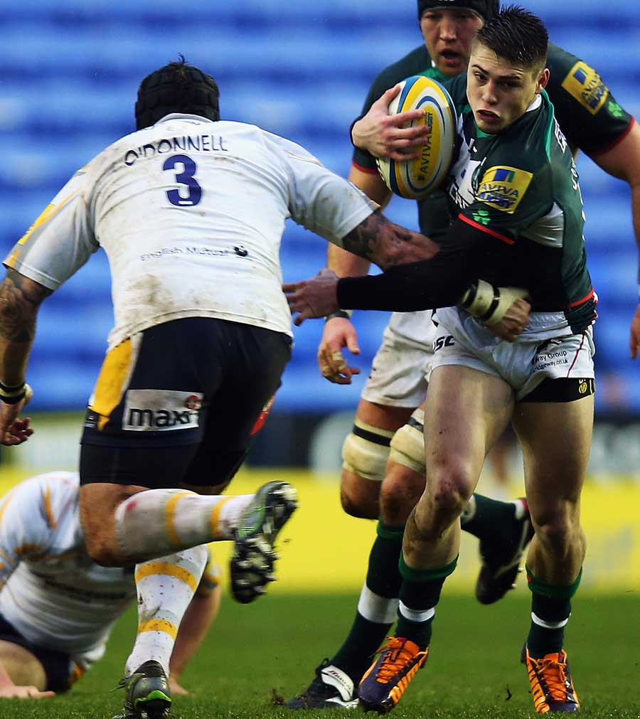 London Irish's James O'Connor jinks his way past the Worcester defender