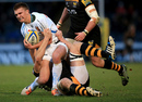Henry Slade of Exeter is tackled by Joe Launchbury at Adams Park