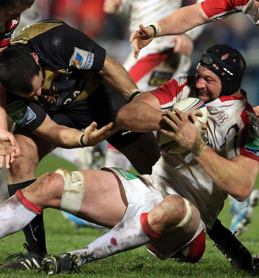 Ulster's Dan Tuohy struggles to keep hold of the ball against Montpellier