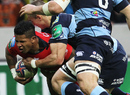 Try-scorer David Smith powers through a Cardiff tackle