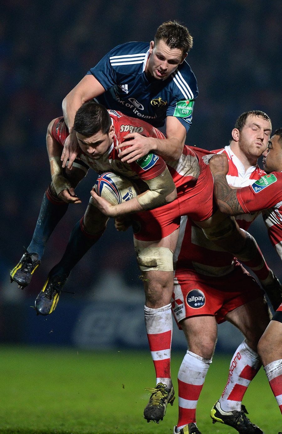 Munster's Dave Foley and Elliott Stooke of Gloucester tussle in the air