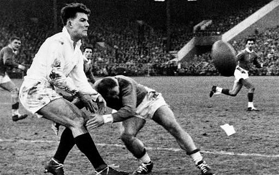 Gordon Waddell passes the ball as he is tackled by Alfred Roques