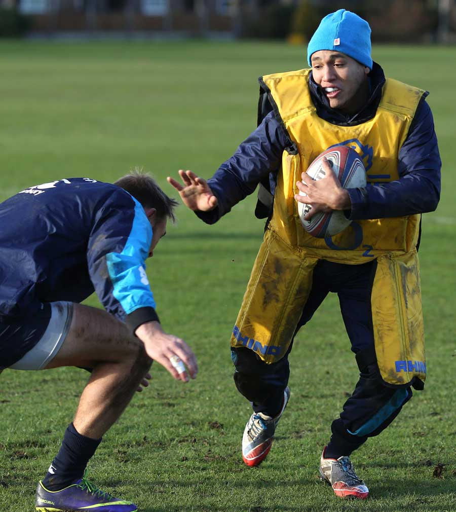 England's Marcus Watson fends off a tackler in training