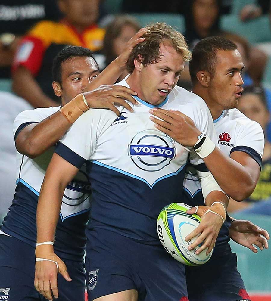 New South Wales' Stephen Hoiles is congratulated after scoring
