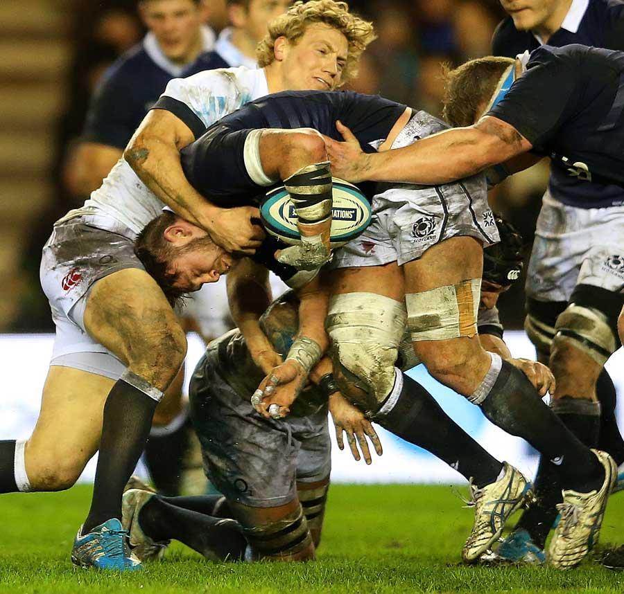 Scotland's Ryan Wilson carries into Billy Twelvetrees