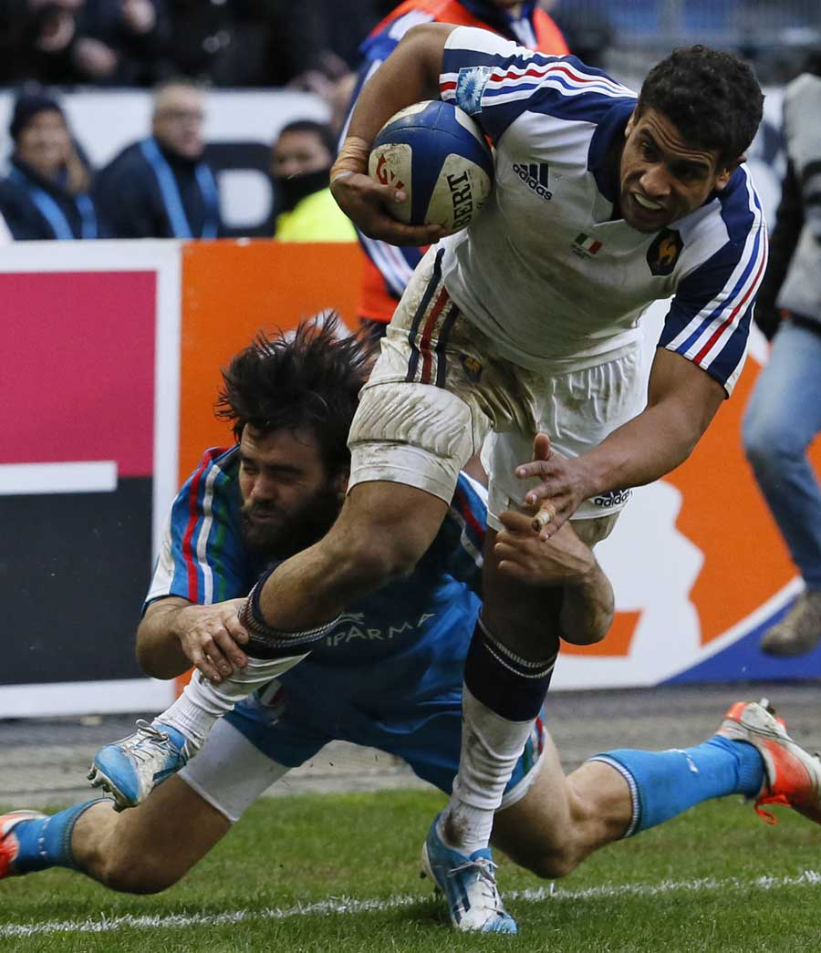 France's Wesley Fofana brushes off the attempted tackle from Luke McLean