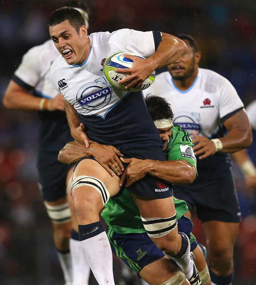Dave Dennis of the Waratahs charges ahead