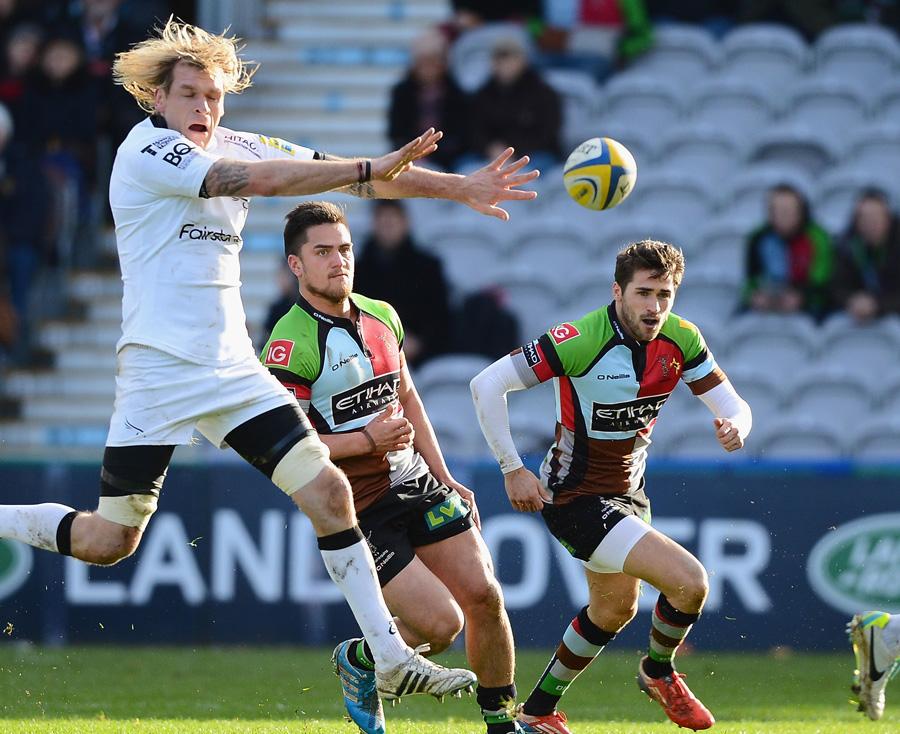 Ben Botica's kick beats the jump of a Newcastle defender