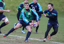 George Ford passes the ball during the England training session at Pennyhill Park