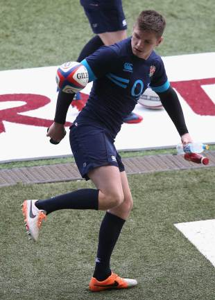 England's Owen Farrell juggles a ball ahead of the captain's run, February 21, 2014