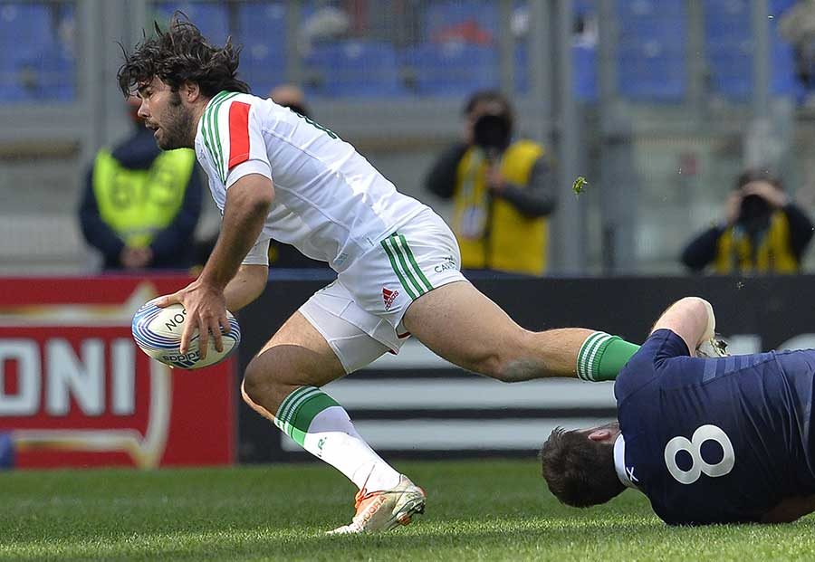 Italy's Luke McLean attempts to make ground against Scotland