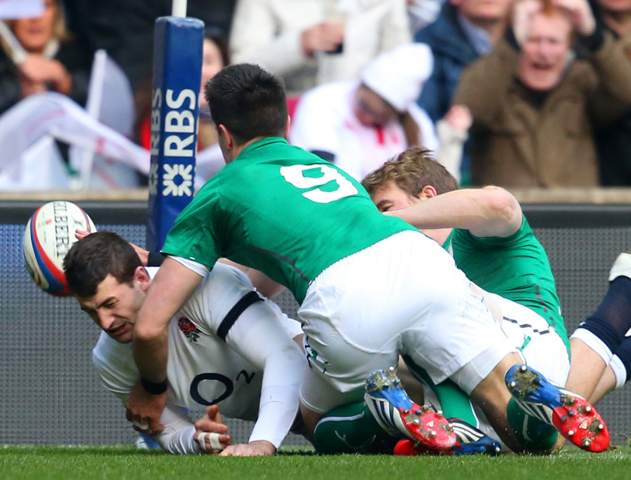 Conor Murray gets across to deny Jonny May a certain try on the line