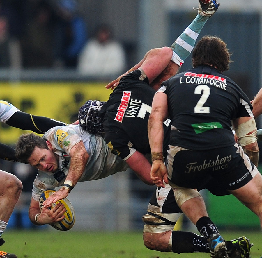 Exeter's Ben White dump tackles Darren Allinson, for which he recieves a yellow card