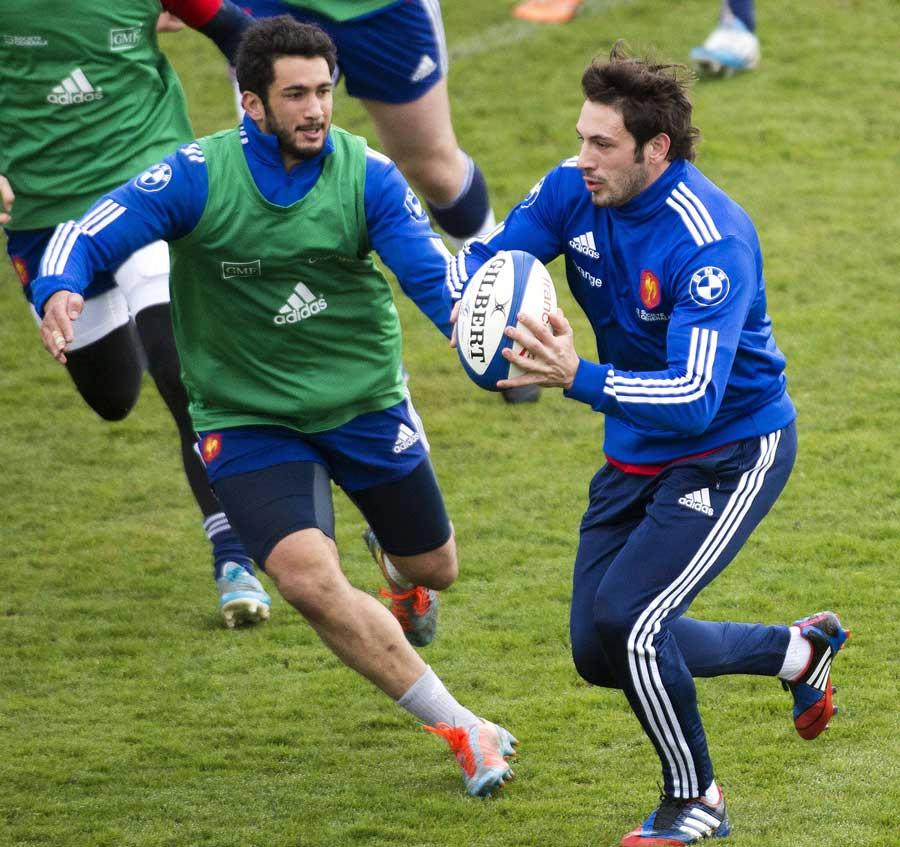 France's Remi Lamerat runs the ball in training