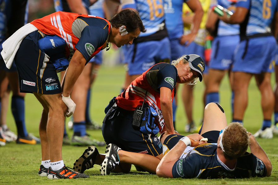 David Pocock gets treatment after injuring his knee