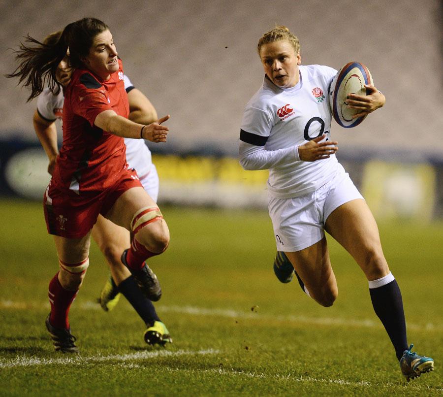 Kay Wilson of England gets away from Nia Davies