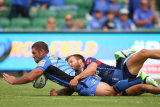 Western Force's Matt Hodgson crashes over the whitewash during his 100th match, Western Force v Melbourne Rebels, Super Rugby, March 8, 2014