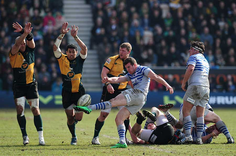 Ben Spencer attempts to clear Saracens' lines