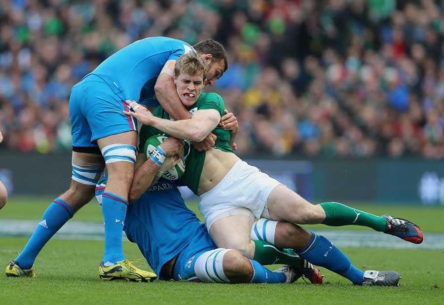Andrew Trimble is tackled by Italy's Marco Bortolami