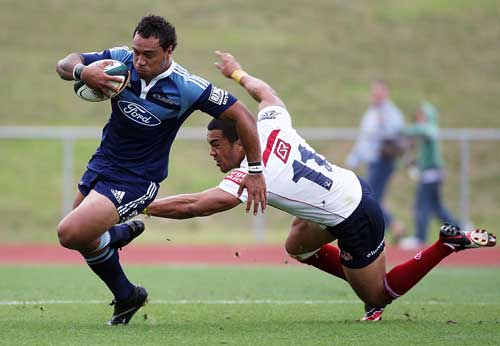 The Blues' Anthony Tuitavake evades the Reds' defence