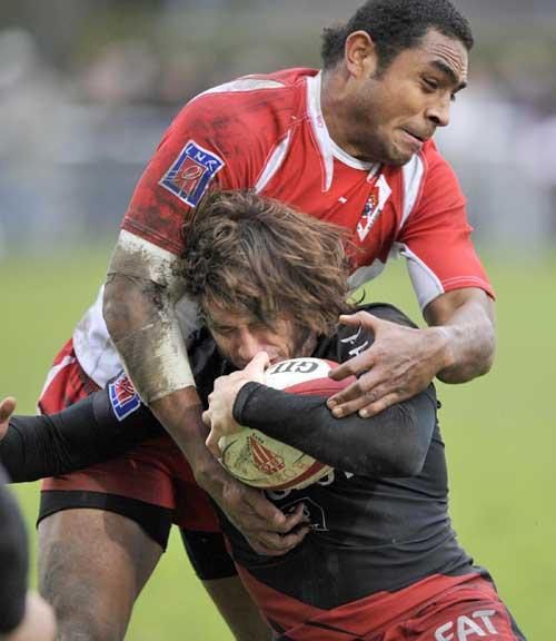 Biarritz's flanker Samiu Vahafolau tackles Toulouse's Maxime Medard