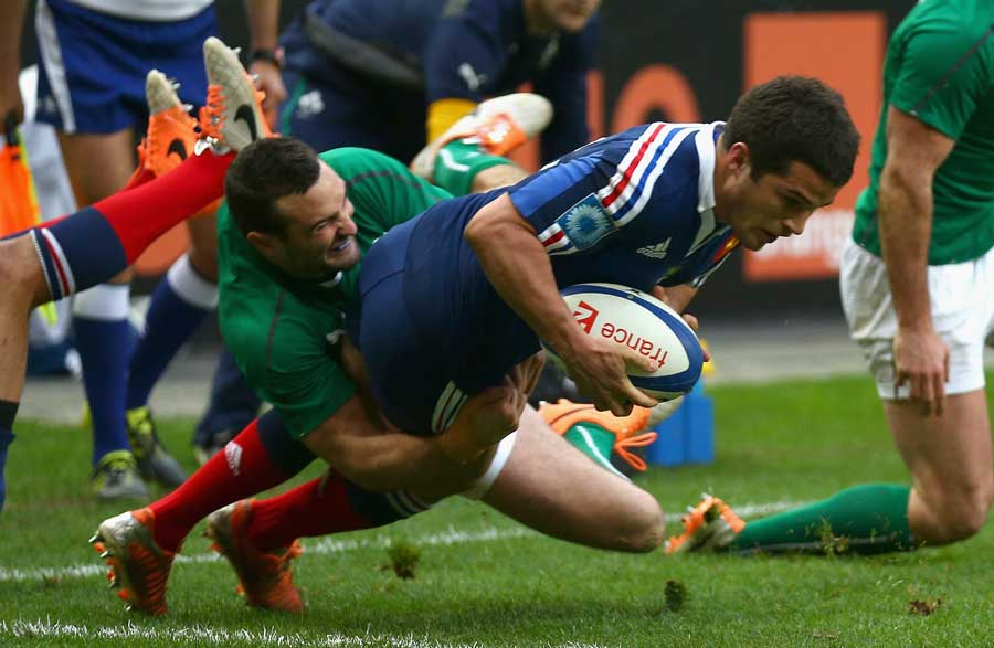 France's Brice Dulin prepares to ground the ball