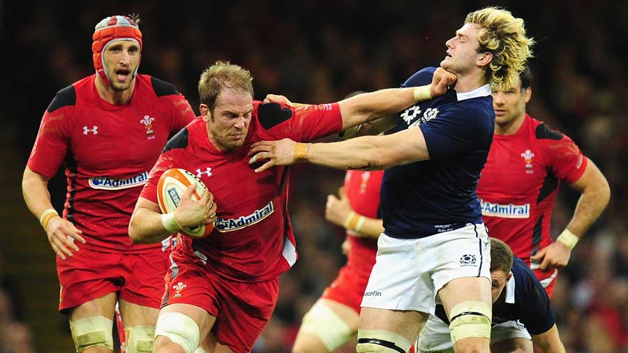 Scotland's Richie Gray is on the wrong end of an Alun Wyn Jones hand-off