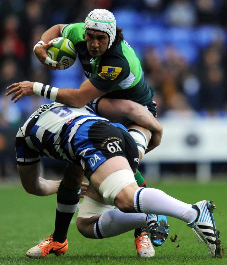 London Irish's Blair Cowan tries to dodge past Dave Attwood