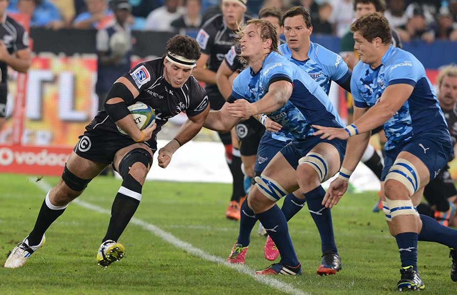 The Sharks' Marcel Coetzee takes the ball into contact against the Bulls