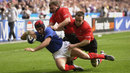 Vincent Clerc of France dives over to score