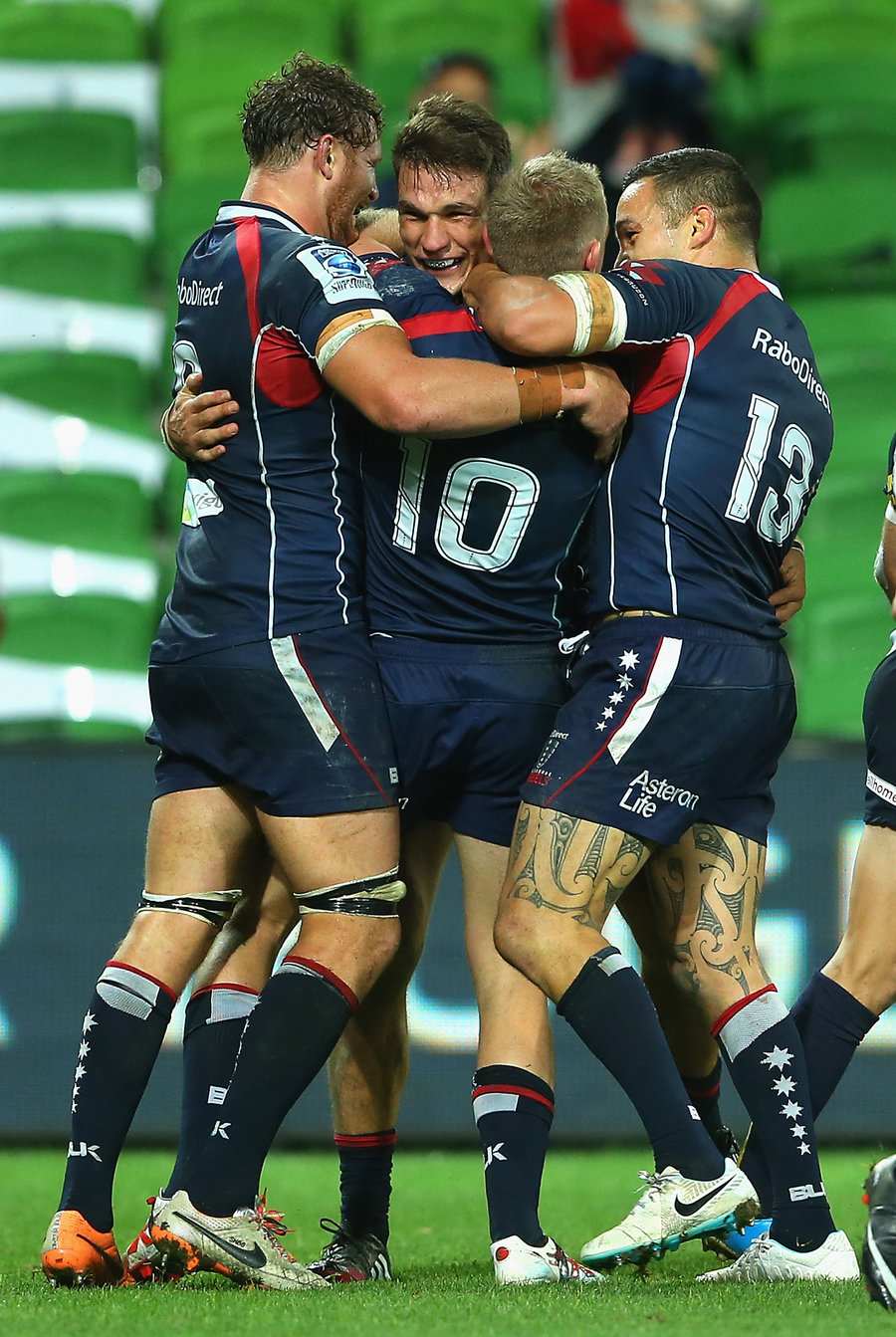 Rebels players congratulate Mitch Inman for scoring