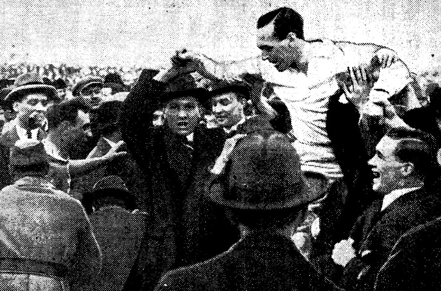 WJA 'Dave' Davies is carried from the field after England's win