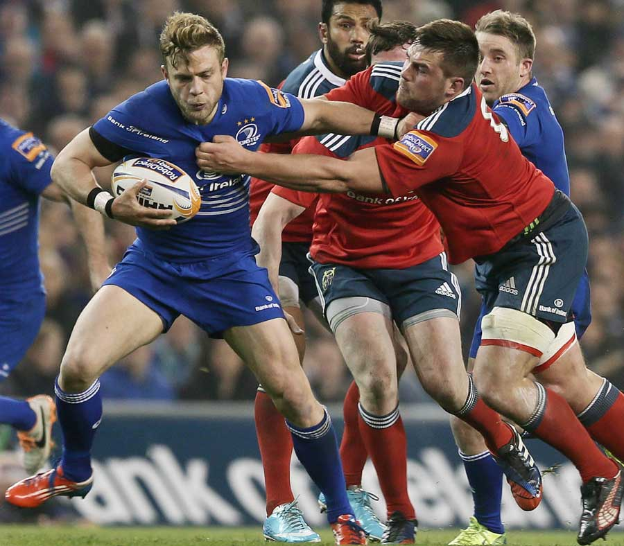 Leinster's Ian Madigan tries to break away from the Munster defence