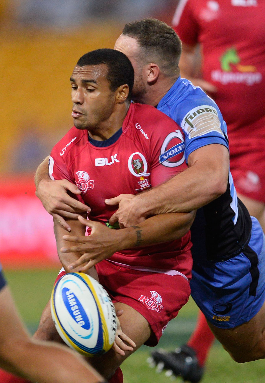 Will Genia is crunched in a tackle