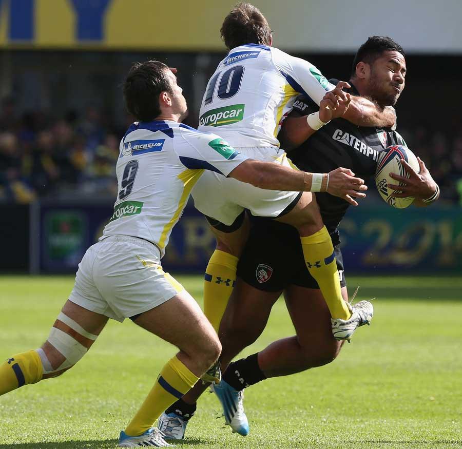 Morgan Parra and Brock James try to bring down Manu Tuilagi