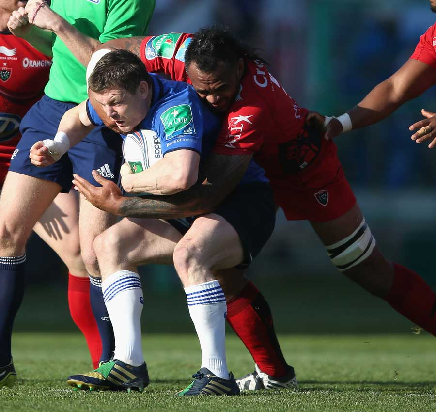 Leinster's Brian O'Driscoll is tackled by Jocelino Suta