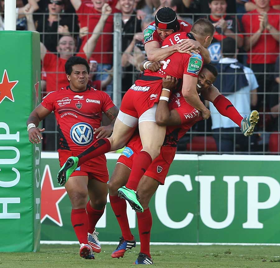 Toulon's Drew Mitchell is mobbed after his try