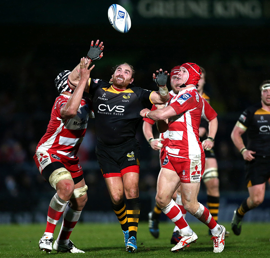 Wasps' Andy Goode is put under pressure by Gloucester