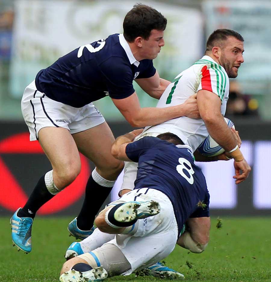 Italy's Robert Barbieri carries forward against Scotland