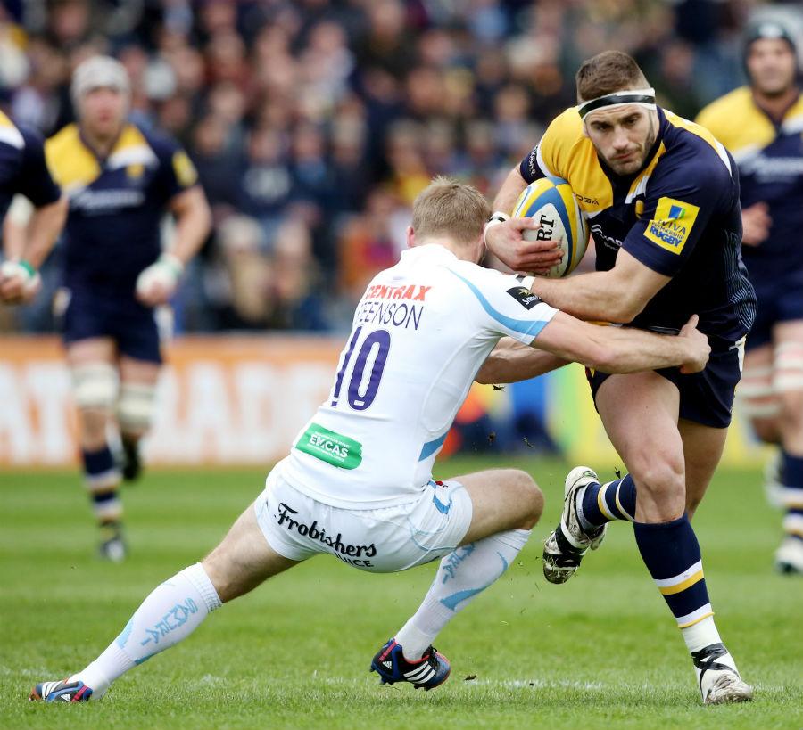 Sam Betty  evades Gareth Steenson