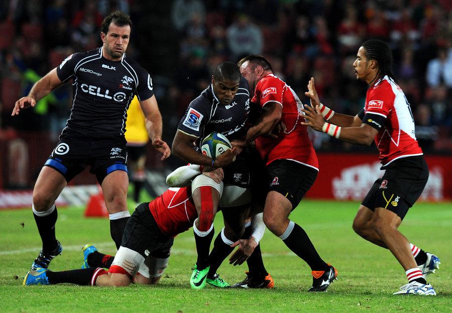 Sharks' Sibusiso Sithole takes on three Lions' defenders