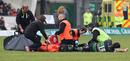 Northampton hooker Matt Williams receives treatment for a suspected broken leg