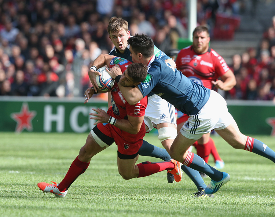 Sebastien Tillous-Borde of Toulon is tackled high by Conor Murray