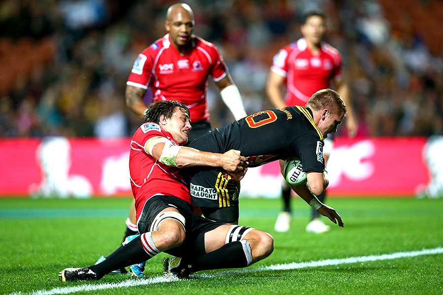 The Chiefs' Gareth Anscombe breaks the tackle of Franco Mostert to score a try