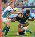 Jono Ross of the Bulls tackled by Andriaan Strauss of the Cheetahs