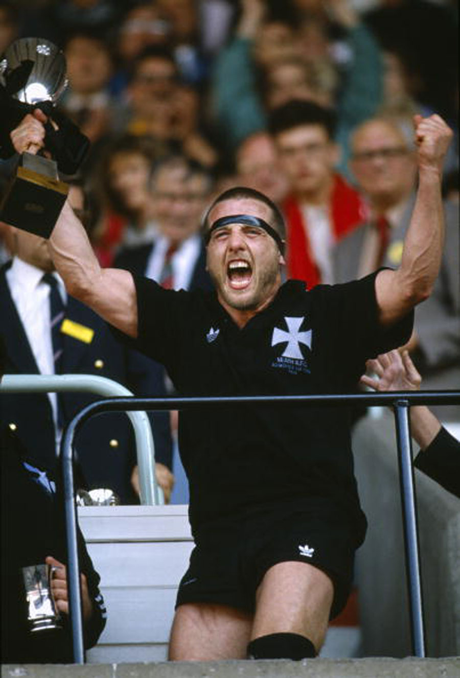 Neath's Kevin Phillips shows his excitement as he celebrates with the trophy