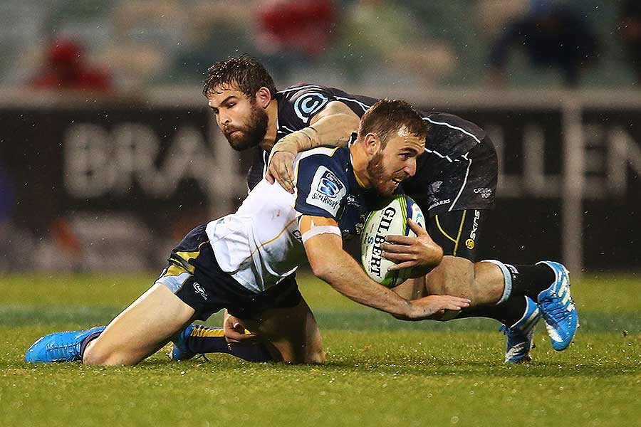 The Sharks' Cobus Reinach tackles the Brumbies' Nic White