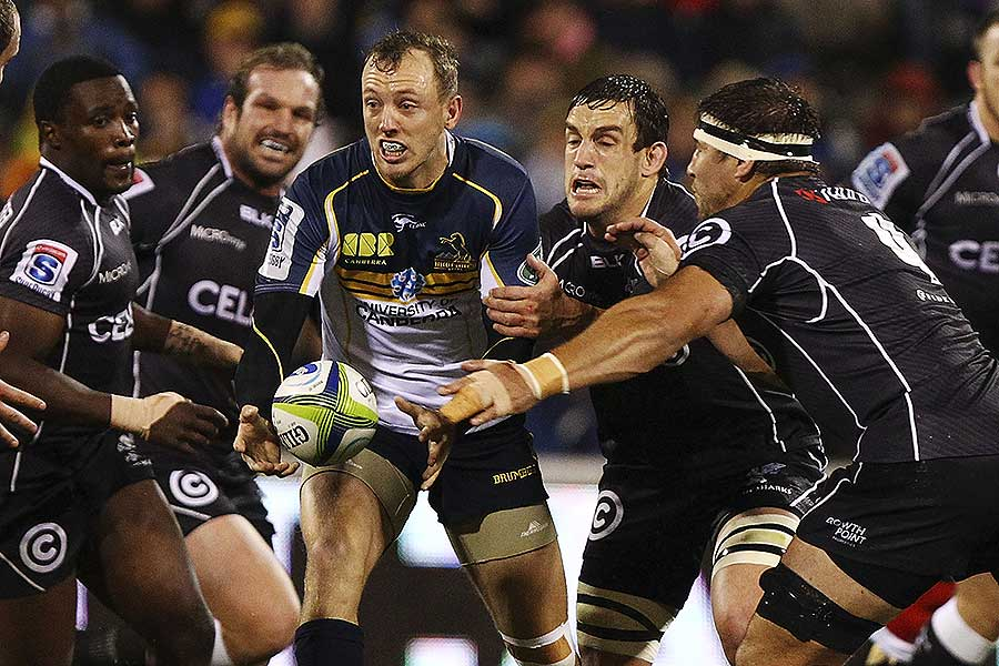 The Brumbies' Jesse Mogg passes the ball under pressure