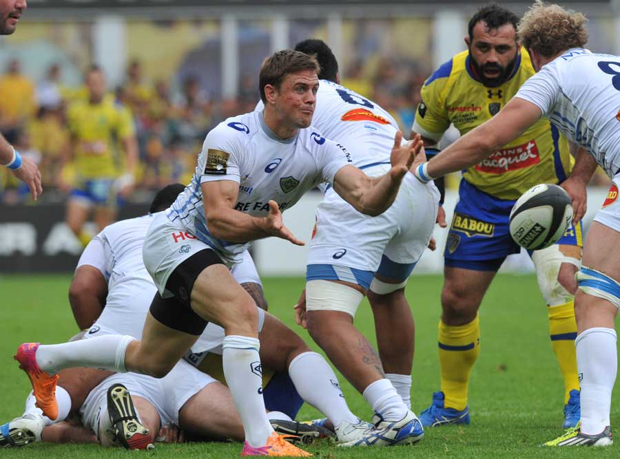 Castres' Rory Kockott wings the ball out