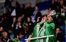 A London Irish fan shows his colours
